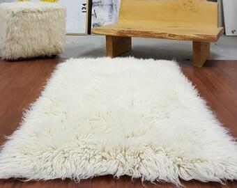EXTRA ORDINARY 3x5 Natural White Flokati Rug. Boasts A 4