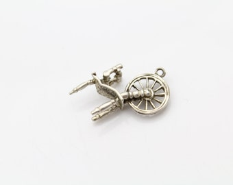 Vintage 3-D Spinning Wheel Charm in Sterling Silver. [10371]
