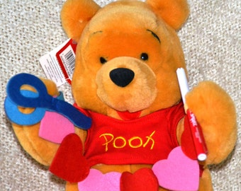 """VALENTINE POOH with HEART.. 13"""" , Made especially for """"The Disney Store"""" Plush Pooh holding Cut out Hearts, Scissors, Red Marker, New/Tags!"""