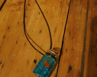 Floating heart bottle necklace