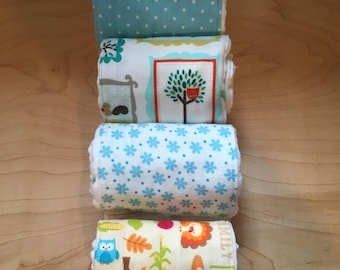 Set of Four Flannel Burp Cloths for a baby boy in blues and earth tones