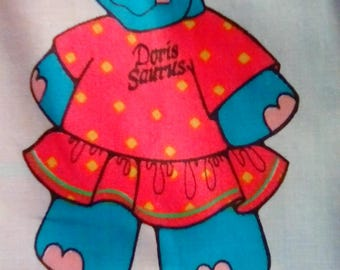 Doris Saudis Female Dinosaur, Daisy Kingdom 1993 fabric oop Comes with clothes on panel