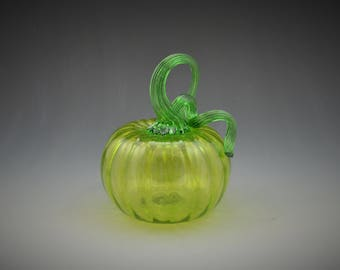 Vibrant Lime Green pumpkin with a brilliant green stem.