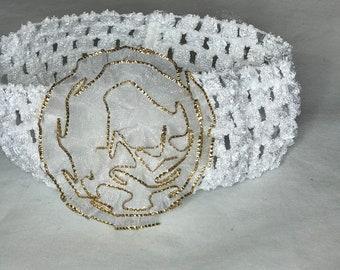 handmade gold trimmed flower crochet headband