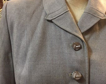 Crisp dove grey suit of the 1950s