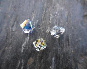 Crystal Swarovski bicone 8 mm: 3 beads crystal AB.