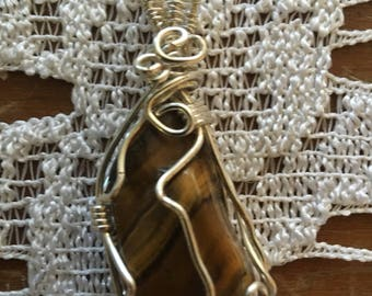 Tigers eye wire wrapped pendant