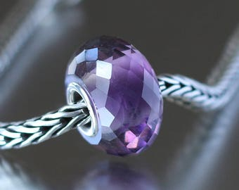 Purple and clear faceted glass bead 2-13
