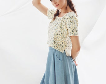 Circular and high waisted skirt with pockets. Blue Tencel.