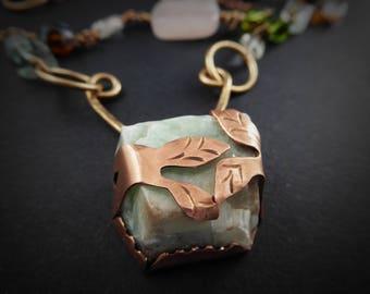 Green Calcite Quartz captured in copper leaves, with rose quartz, carnelian, crystal quartz, tourmaline, glass beads, mixed metals