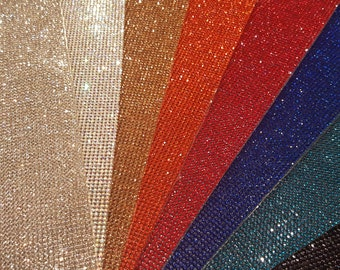 DMC Hotfix Rhinestone Sheets.  HOT ITEM for Cheer bows and so much more!!!   9.25 X 15.5