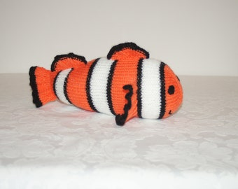 Hand knitted clown fish inspired by Nemo, made by Liz