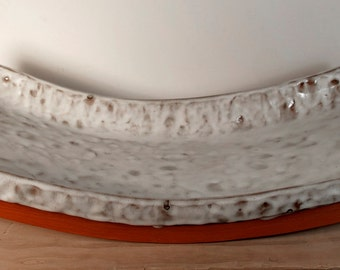 Curved white earthenware platter