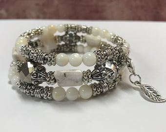 white agate beaded memory wire coil bracelet with silver spacers and shell beads