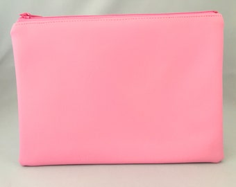 Nappy clutch/pouch made in Pink faux leather. Colourful wash bag, travel bag, zippered bag, nappy bag. Bright colour pop.
