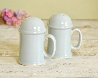 Pair of vintage salt and pepper shakers, pale grey blue glazed ceramic cruet