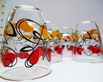 Set of four midcentury shot glasses with abstract atomic pattern - great design - very Mad Men