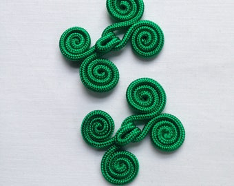 Pair of vintage green hook buttons