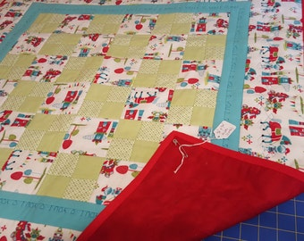 Knights - handmade red and turquoise flannel baby quilt