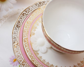 Elegant pink, gold teaset:  pretty pink and gold Salisbury  bone china tea cup, saucer and tea plate.