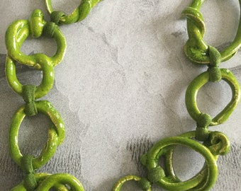 Bright green ceramic necklace with irregular rings