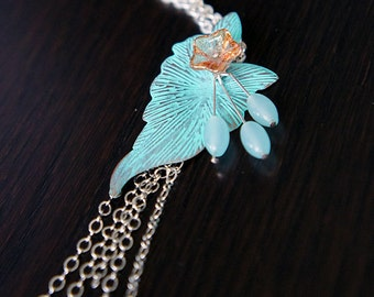 Handmade necklace with patina leaf pendant