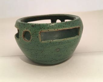 Hand thrown pottery bowl wth cutout border