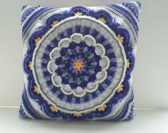 Cushion Cover Crocheted in colours of Light purple White and Blueish Purple.
