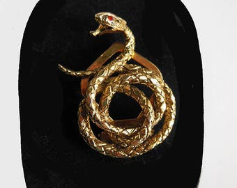 Vintage coiled serpent dress clip/brooch. Signed ART