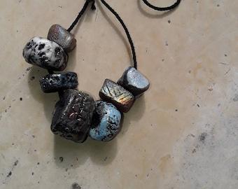 seven beads raku ceramic dominant green and blue
