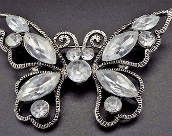 Gorgeous Vintage Butterfly Rhinestone Brooch . Beautiful Rhinestones in a Silver tone setting.