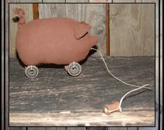 Primitive rust colored piggie, piggy, pig pull toy HAFAIR HAGUILD