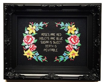 Roses are red violets are blue sugar is sweet death is inevitable. Finished and framed cross stitch.