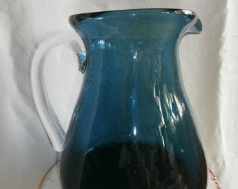Vintage old pitcher blue bubbles with mouth blown glass