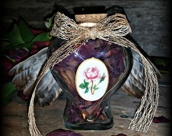 Heart Shaped Bottle of Red Dried Rose Petals