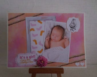 girl with pink and orange feet birth card, cradle