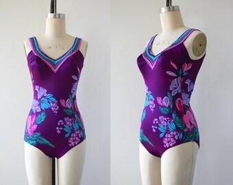 vintage 1970s swimsuit / late 1970s early 1980s one piece bathing suit / purple floral swim suit / tropical print swimwear / medium
