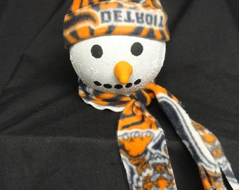 An adorable light up snow person in a fleece Detroit Tigers hat and scarf