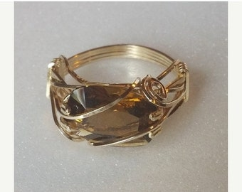 End of May Sale Whisky Quartz is a natural stone, here cushion cut and set east-west in a 14K gold filled prong setting with accent wires.