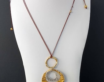 Necklace with gold and silver plated wrought pendant