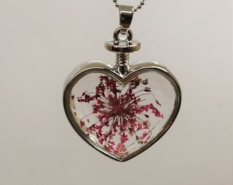 Pink dry flower in the CK117 glass heart pendant