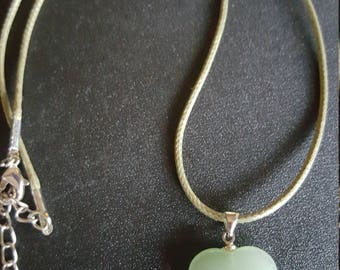 Green gemstone heart pendant on cord necklace