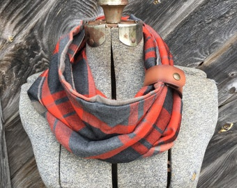 Orange and gray plaid scarf with a brown leather cuff