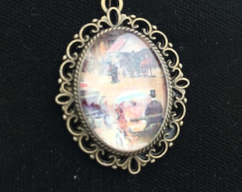 Pendant, handmade, oval with victorian scene in the background
