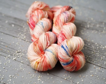 Cabana Peach Orange with Blue Yellow Red Speckled Hand Dyed Yarn // Superwash Merino and Nylon Sock Fingering Weight Yarn // Cape May Fiber