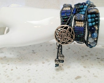 Handmade one of a kind blue beaded 3 wrap bracelet with charms