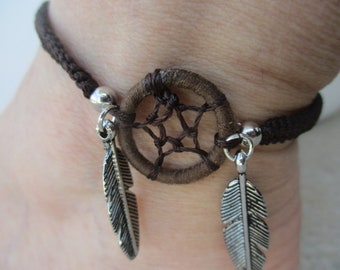 """Dream Catcher Anklet. Brown Cord Weaved with Silver plated feathers. Hand Macrame stitched. Adjusts from a 9"""" up to a 13 1/4"""" length."""