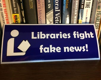 Libraries Fight Fake News! Bumper Sticker or Magnet in Purple