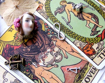 Two voices, a tarot and charm reading combined, a diviners combo.