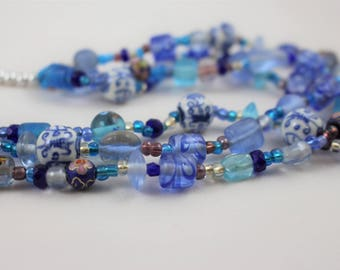 Handmade 3-stranded tiered blue and white beaded necklace with toggle closure